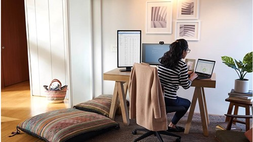Woman working remotely at desk